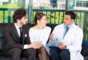 Young couple gets counseled by a doctor