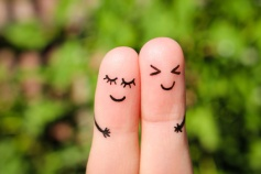 Finger art of a Happy couple. The concept of couple laughing.